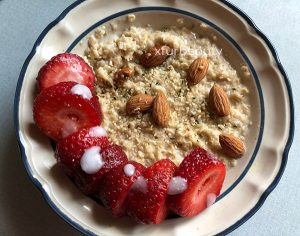 My Breakfast: Homemade Oatmeal with Strawberries, Hemp Seeds, and Almonds.