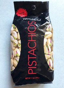 A new bag of Wonderful Pistachios Sweet Chili.